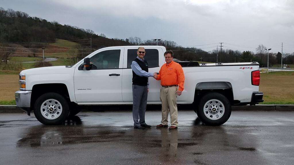 Seth Rye of Rye Engineering stands with Jonathan Overly of ETCleanFuels in front of his bi-fuel CNG Chevy Silverado.