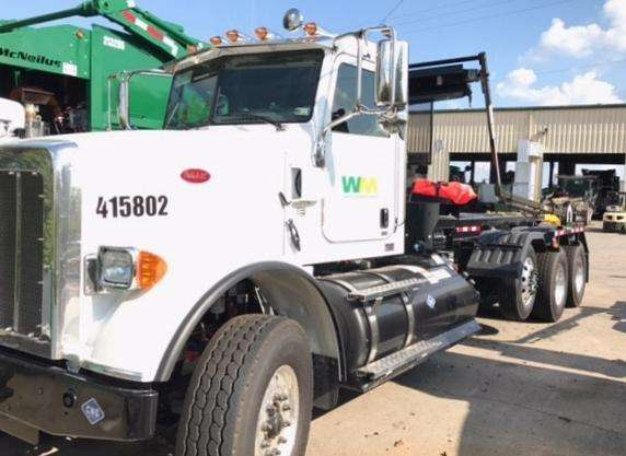 A CNG-powered roll-off truck that Waste Management has put into service in Tennessee. It is used to to move large refuse containers.