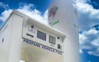 "Blue sky with ""Propane Vehicle Fuel"" refilling station in view"